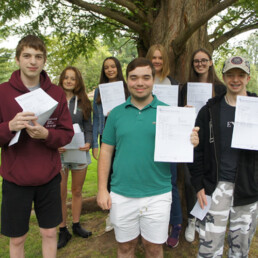 Students celebrating their GCSE exam results